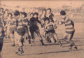 Flyhalf Clarky looking to slice through, with Emu in support in the 1975 1st Grade GF.